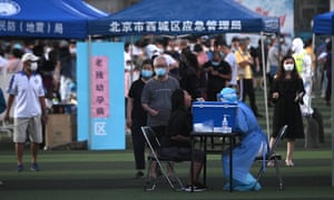 Swab testing at Guangan Sport Center for people who visited or live near the Xinfadi Market in Beijing on 14 June 2020.