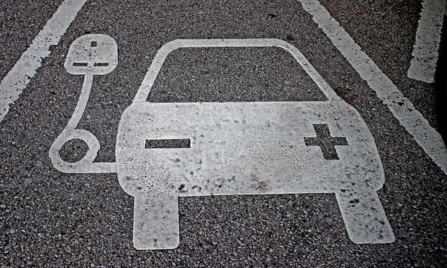 a car charging parking bay sign
