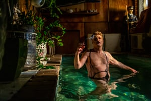 A man smoking in a pool.