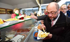 Martin Schulz eats chips and sausages on the campaign trail.