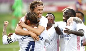 Real Madrid's Luka Modric celebrates with team mates scoring his side's third goal.