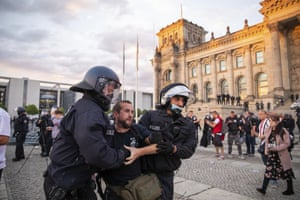 Police officers push away a crowd of demonstrators from the square 'Platz der Republik' in front of the Reichstag building during a demonstration against the Corona measures in Berlin, Germany, Saturday, 29 August, 2020.