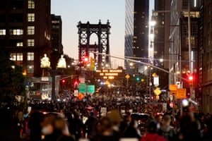 Activists march over the Manhattan bridge during a rally on May 31, 2020 in the Brooklyn borough of New York City. Protesters demonstrated for the fourth straight night after video emerged of a Minneapolis police officer, Derek Chauvin, pinning Floyd's neck to the ground. Floyd was later pronounced dead while in police custody after being transported to Hennepin County Medical Center. The four officers involved have been fired and Chauvin has been arrested and charged with 3rd degree murder.