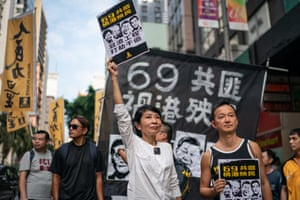 Hong Kong: Pro-democracy protesters take part in a rally on the 69th anniversary of the founding of the People's Republic of China