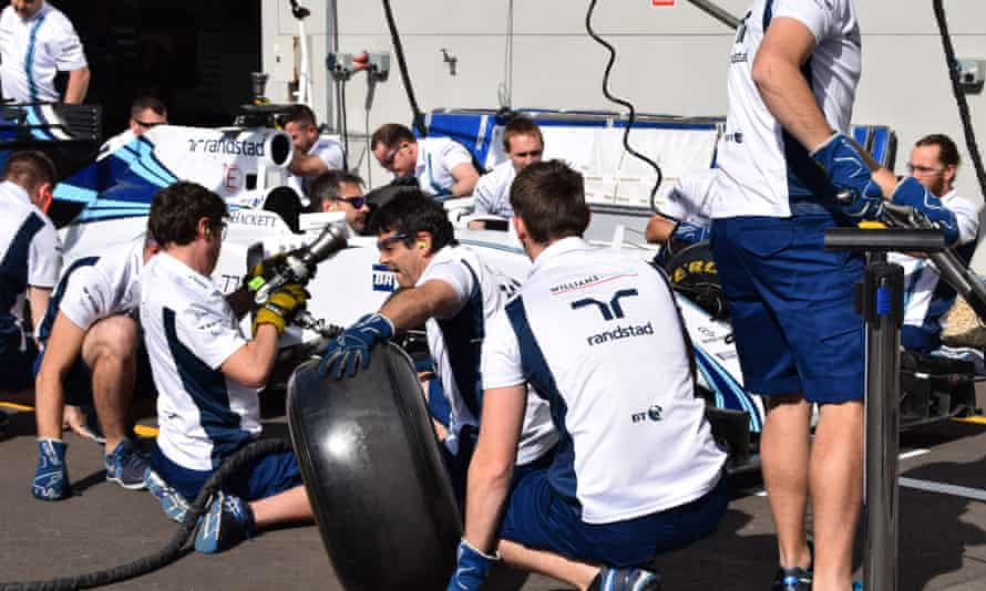 Race against time … the Williams F1 pit-stop team in action.