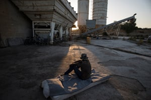 Migrant labourers at an abandoned cement factory in Sicily.