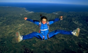 woman jumping from a plane