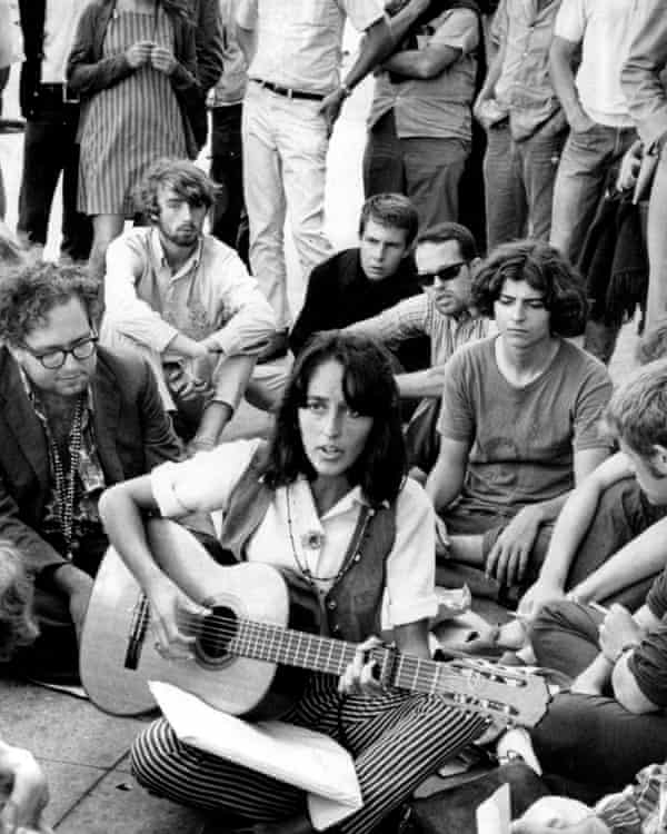 Folk singer Joan Baez plays at the corner of Haight and Ashbury in San Francisco during the Summer of Love in 1967.