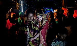 a 15-year-old girl after her marriage ceremony in Manikganj, Bangladesh