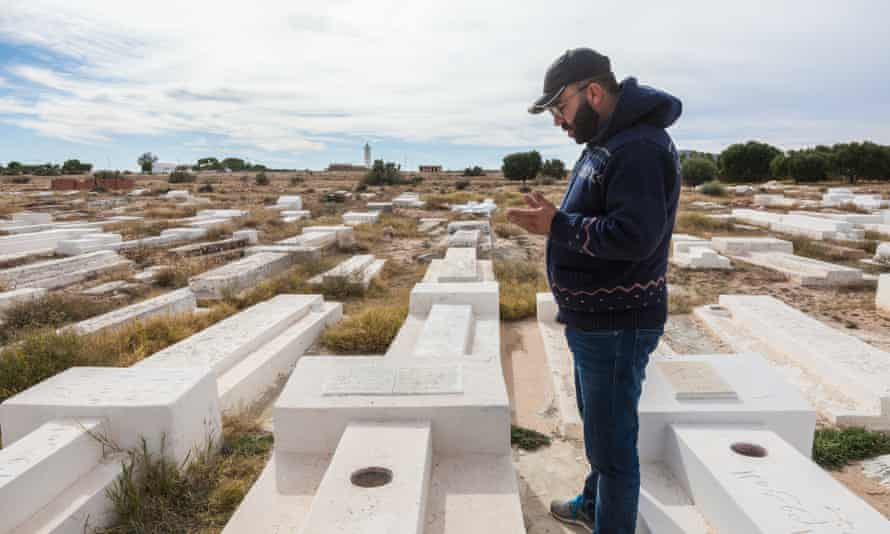 Mohamed Tlili visits the grave of his former schoolmate Mohamed Bouazizi