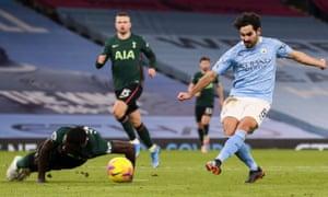 Ilkay Gundogan slots home his second, and Manchester City's third.