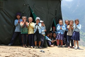 Children welcoming earthquake engineering researchers to Lapsibot in Nepal