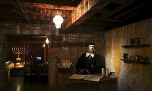 A mannequin of a Jewish money lender with his ledger books in what was once the 16th-century Banco Rosso.