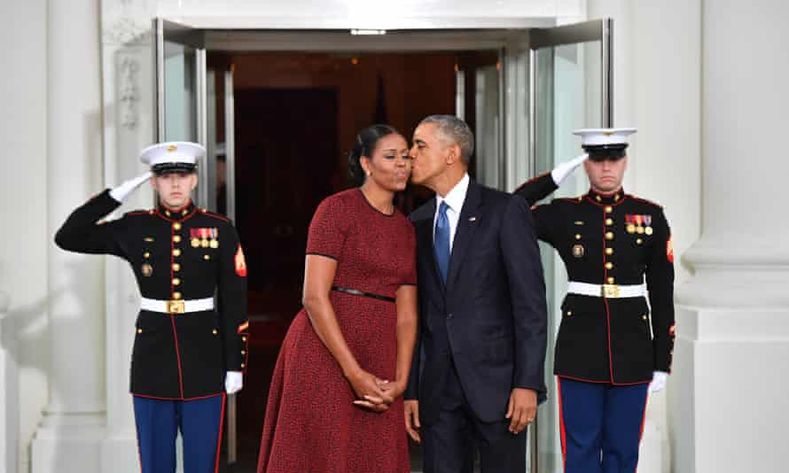 Barack Obama gives Michelle Obama a kiss as they wait for Donald Trump and his wife Melania at the White House before the inauguration in Washington DC on Friday.