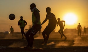 A game of football in Soweto, South Africa. The country's success in bringing its first wave of COVID-19 under control has allowed it to almost fully reopen the economy, while monitoring for signs of a second wave.