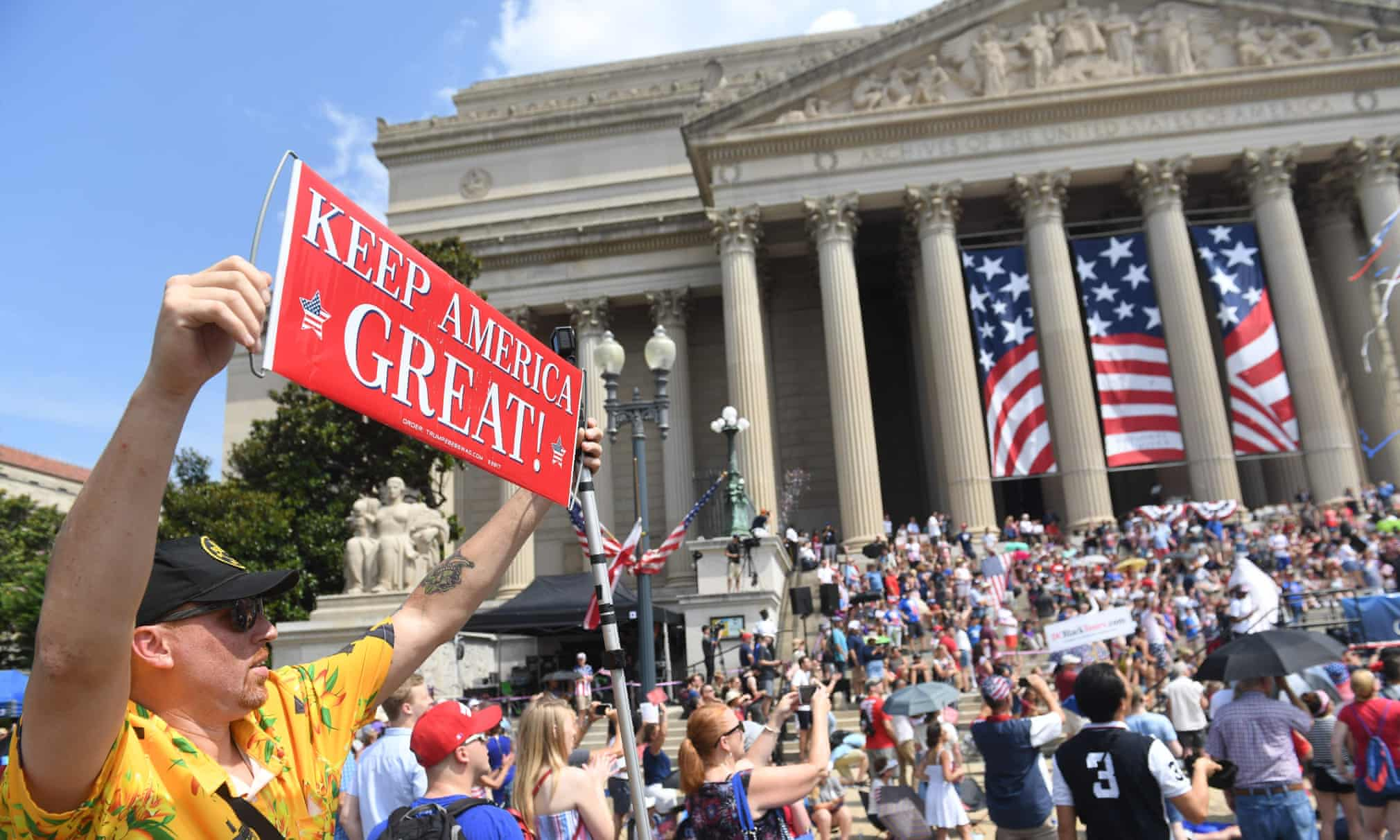 People march in the Independence Day parade in Washington DC on 4 July 2019