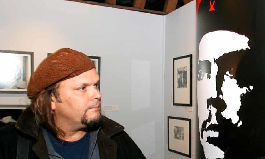 Camilo Guevara, son of Che, comes face to face with the ubiquitous portrait of his father at a 2007 exhibition.