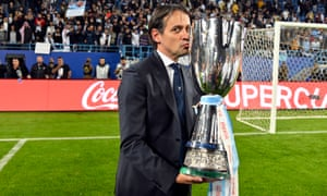 Simone Inzaghi, the Lazio coach, celebrates with the Supercoppa trophy in Riyadh, and his team's second 3-1 defeat of Juventus in a fortnight.