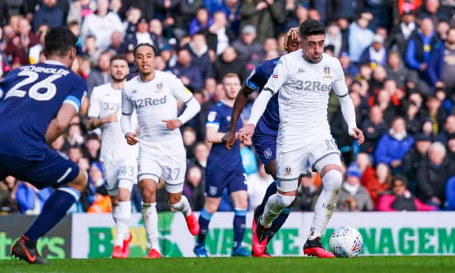 Leeds, in action here against Huddersfield, are in talks over a possible wage deferral.