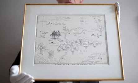 Philip Errington holds the map of Winnie-the-Pooh's Hundred Acre Wood