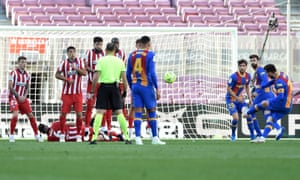 Barcelona's Lionel Messi goes close with a free kick.