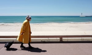 A woman walking along the Croisette at Cannes, 12 May 2020.