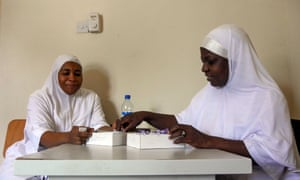 Nurse-midwife Zainab Malut (right) sorts out supplies with a colleague at their family planning clinic in Maiduguri.