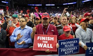 Supporters cheer as US President Donald Trump speaks during a campaign rally at the Toyota Center in Houston, Texas, 22 October 2018.