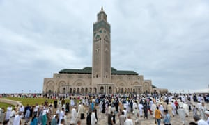 Muslims are gathering to perform Eid al-Fitr prayer at Hassan II Mosque in Casablanca, Morocco.