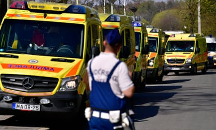 Ambulances wait near an elderly care home in Budapest on Thursday where five people have reportedly died and more than 100 others have been infected with coronavirus.