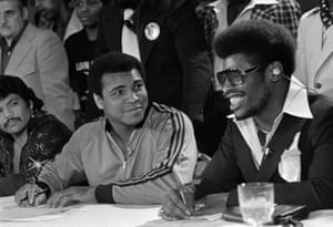 Heavyweight champion Leon Spinks smiles at a remark by Muhammad Ali at the close of a television interview ahead of their rematch in New Orleans in 1978.