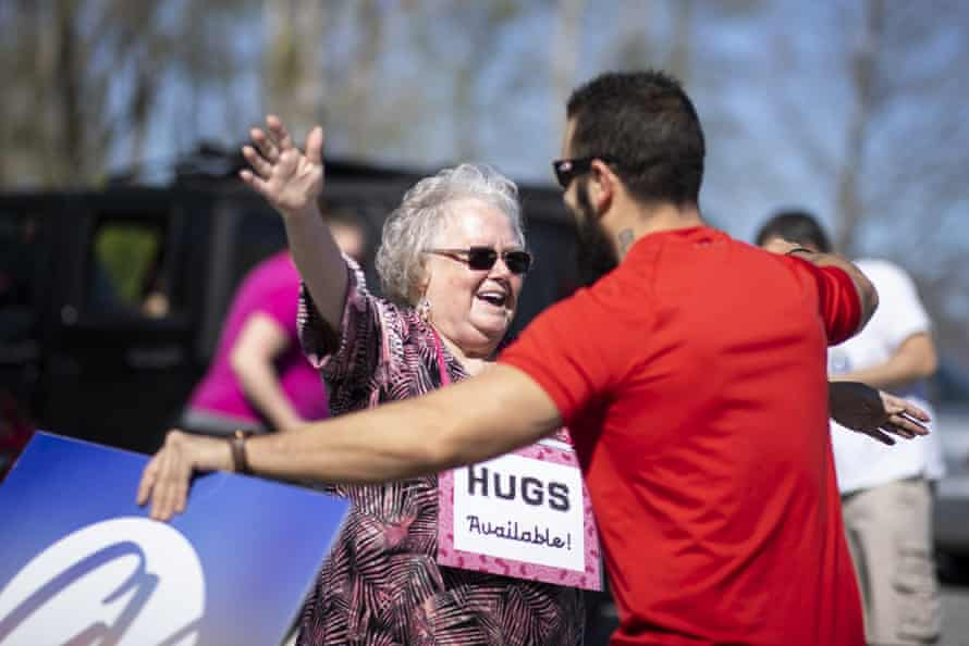 Billy Kennedy offers hugs to parishioners at a parking lot church service on 29 March in Mount Juliet, Tennessee.