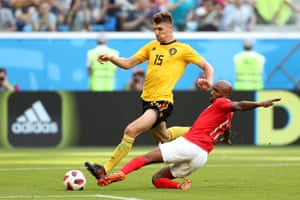 Fabian Delph of England does well to deny Thomas Meunier of Belgium.