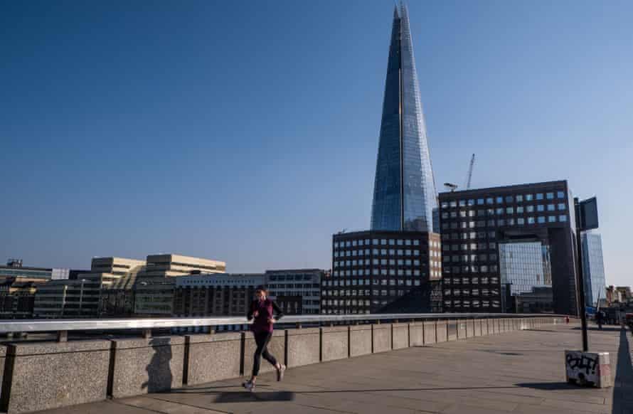 A jogger runs across a deserted London Bridge amid the capital's coronavirus lockdown.