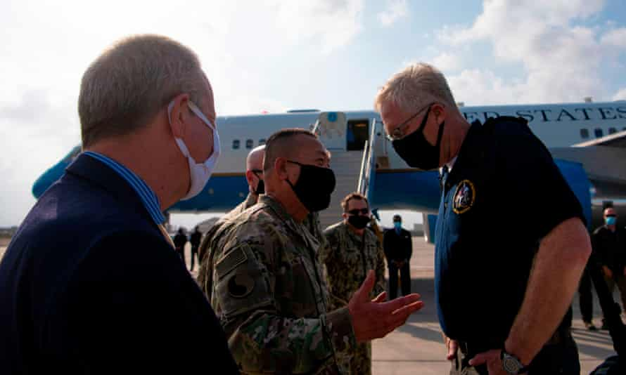 The acting US defense secretary, Christopher Miller, greets Maj Gen Lapthe Flora, the commanding general of combined joint taskforce – horn of Africa, which is involved in Somalia operations, last month.