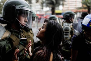 Santiago, Chile A woman confronts a member of the security forces at an anti-government protest