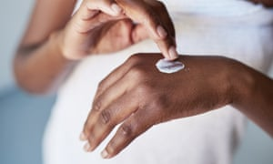Cropped shot of an unrecognisable woman applying moisturiser to her hands