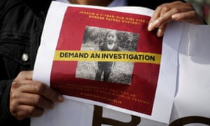 A woman holds a photo of Jakelin Caal during a protest on December 15 in El Paso, Texas.