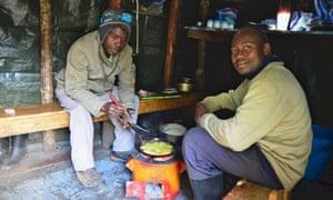 Uganda Rwenzori Mutinda Camp Porters Cooking