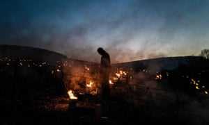 A winegrower from the Daniel-Etienne Defaix wine estate lights anti-frost candles in their vineyard near Chablis, Burgundy, on April 7, 2021 as temperatures fall below zero degrees celsius during the night.