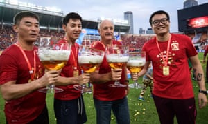 Luiz Felipe Scolari, centre, celebrates winning the Chinese Super League with some of his Guangzhou Evergrande staff. It was the Brazilian's third title in succession