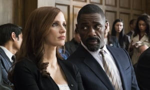 Idris Elba, right, and Jessica Chastain in Molly's Game