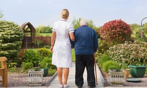 Carer and patient walking in a garden