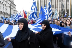 Nuns hold Greek flags during a rally in Athens