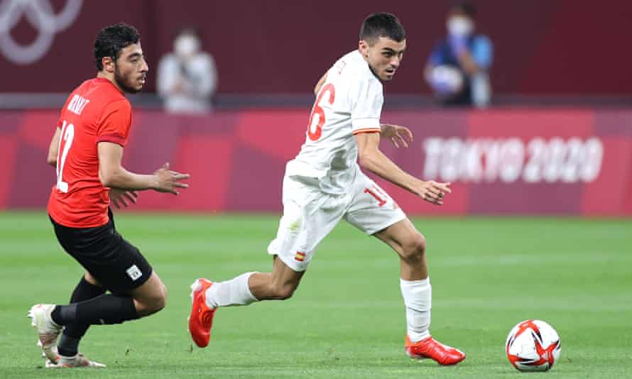 Pedri tries to break away from Akram Tawfik during Spain's goalless draw with Egypt in their opening game at the Olympics.