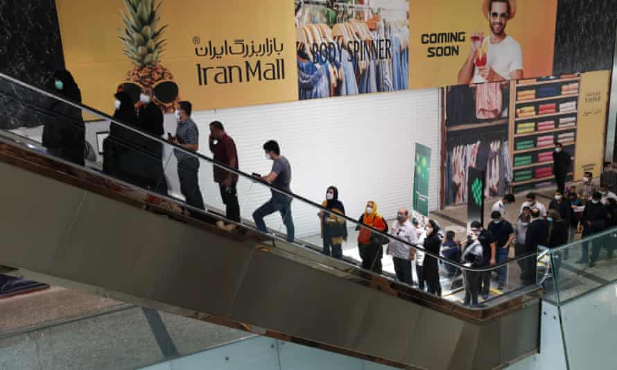 People at a shopping centre where a Covid-19 vaccination centre is located in Tehran