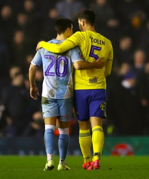 "Coventry City's Liam Walsh and Birmingham City's Maxime Colin embrace after the final whistle. The fixture was played in a friendly atmosphere, with the supporters chanting ""you're supposed to be at home""."