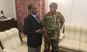 Robert Mugabe talks to General Constantino Chiwenga at State House in Harare