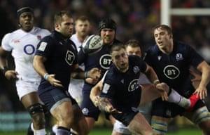 Scotland's Stuart Hogg fumbles the ball.