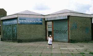 A young girl walking through a housing estate in Skelmersdale, Lancashire